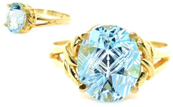4007: 3 CT BLUE TOPAZ GOLD/SILVER