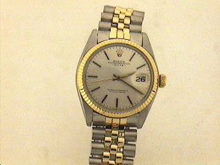 2957: 18K/STAINLESS STEAL ROLEX DATE