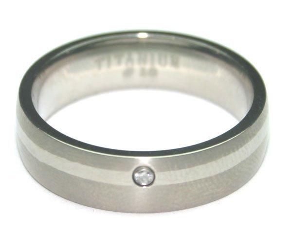 2005: MEN'S  TITANIUM  & DIAMOND  RING.