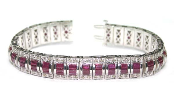 1586: 24. CT DIA &  RUBY  52 GR 14K GOLD BRACELET .