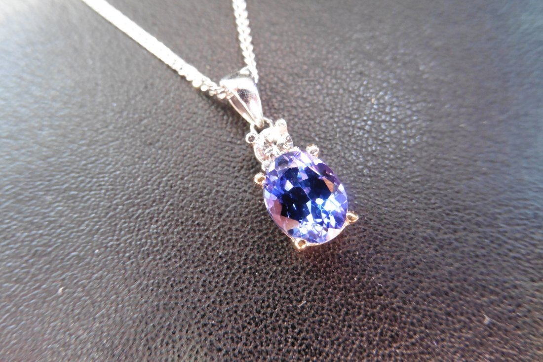 9ct white gold tanzanite and diamond pendant