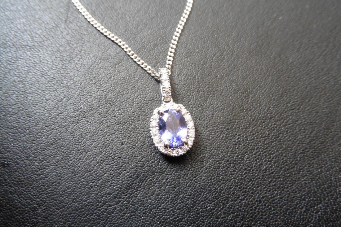 18ct white gold tanzanite and diamond pendant