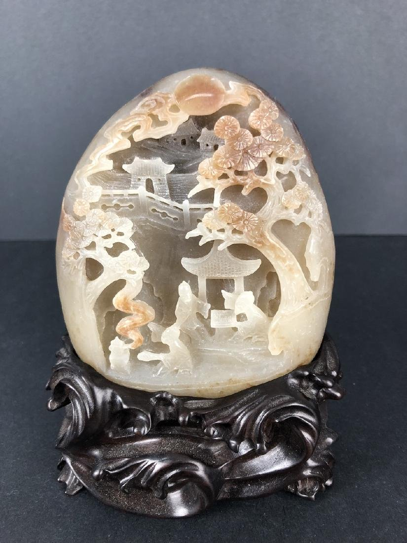 A Hetian Jade Mountain carving with stand