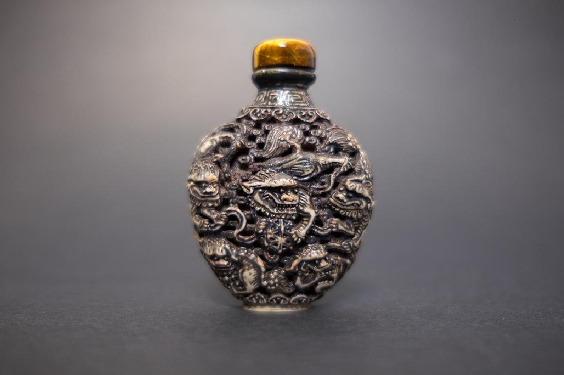 A Carved Design of Shoushan stone Snuff Bottle