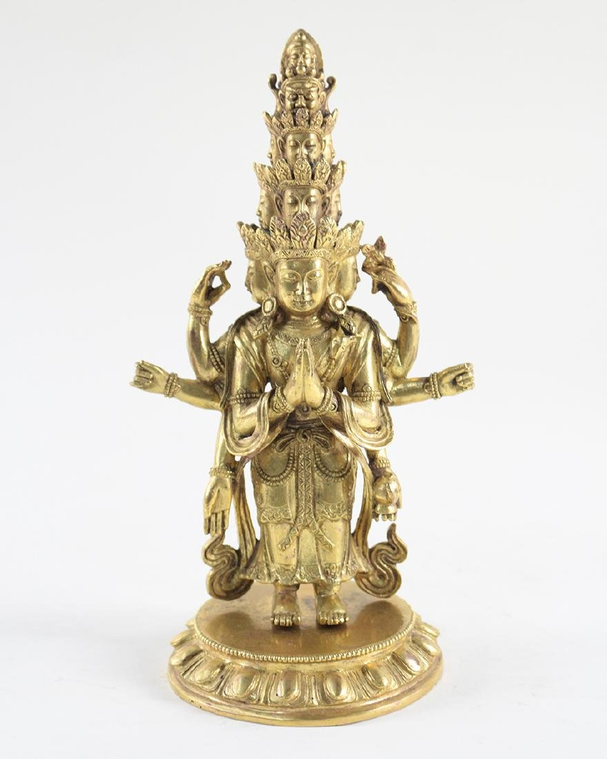 GILT BRONZE ELEVEN-FACE BUDDHA FIGURE