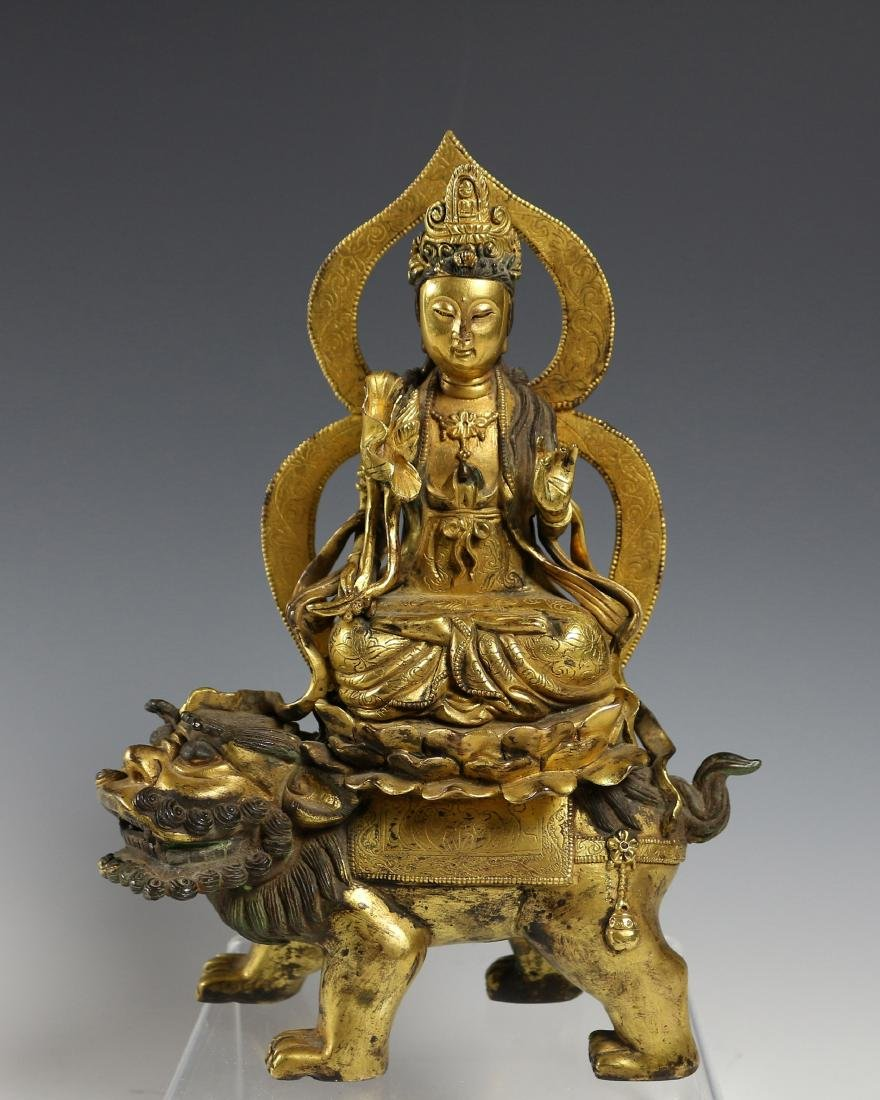 GILT-BRONZE FIGURE OF GUANYIN
