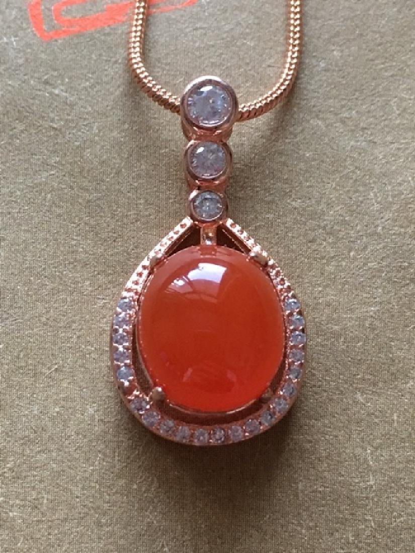 NATURAL EGG-SHAPED SOUTHERN RED AGATE PENDANT