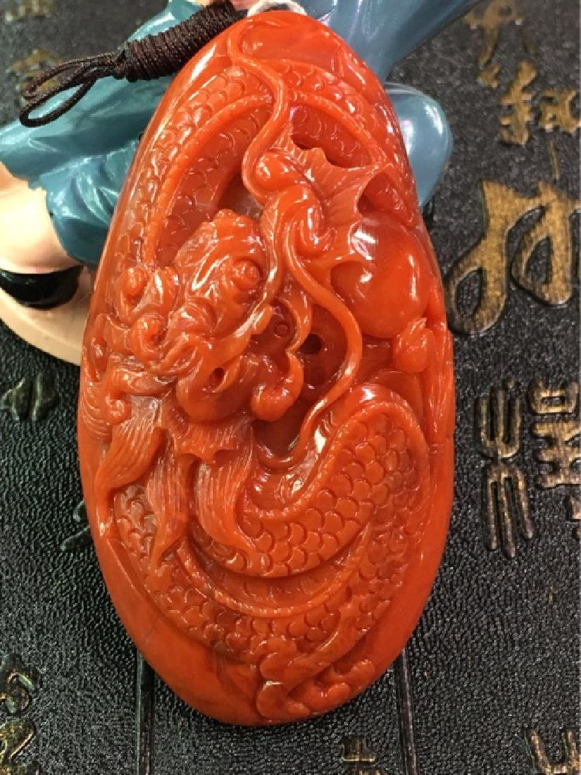 NATURAL DRAGON SHAPED SOUTHERN RED AGATE PENDANT