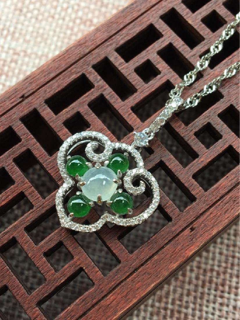 A NATURAL ICY JADEITE BEADS RUYI DESIGN SILVER PENDANT