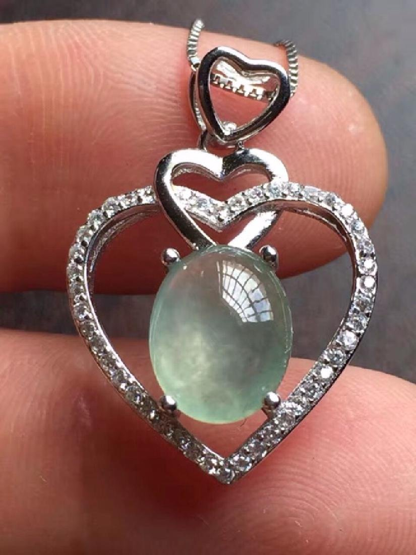 A NATURAL EGG-SHAPED ICY JADEITE SILVER PENDANT