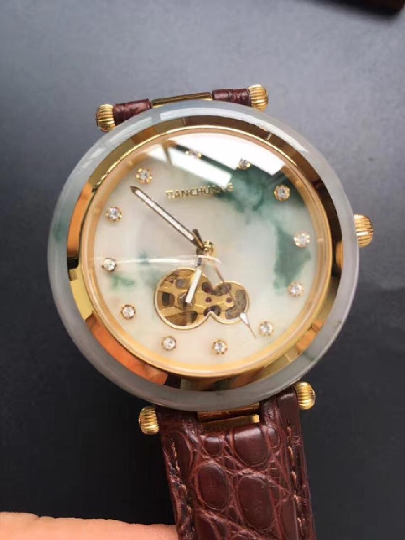 A PIAOHUA JADEITE SURFACE MECHANICAL WATCH