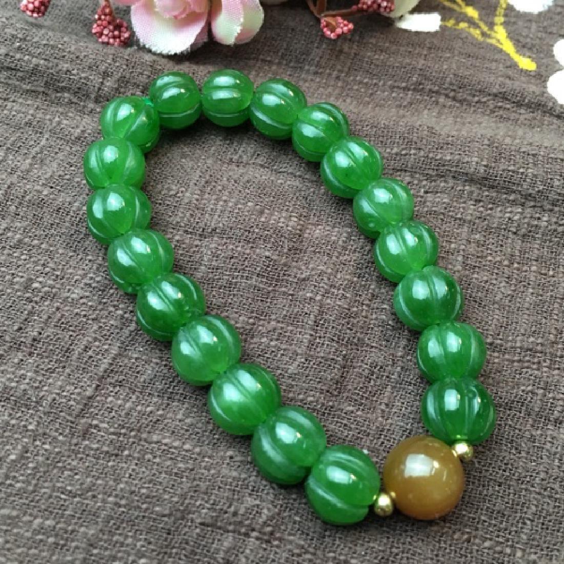 A NATURAL HETIAN GREEN JADE BEADS BRACELET