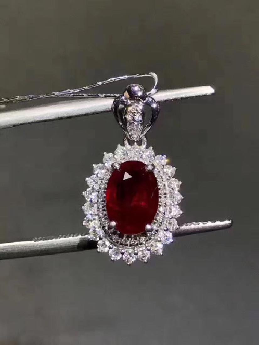 A NATURAL OVAL-SHAPED PIGEON-BLOOD RUBY PENDANT