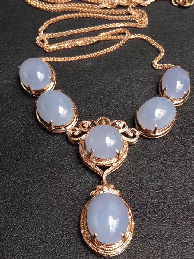 A NATURAL EGG-SHAPED BINGZHONG VIOLET JADEITE NECKLACE