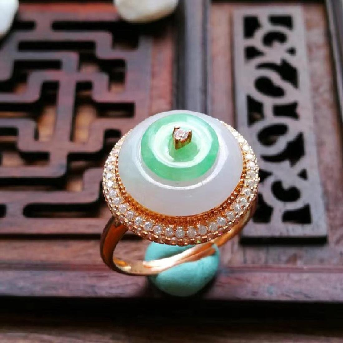 A NATURAL RING-SHAPED ICY JADEITE RING