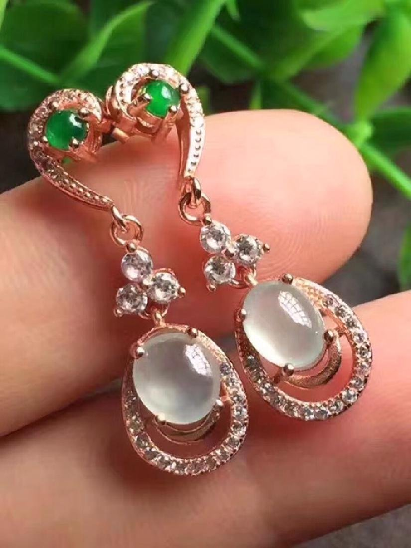 A NATURAL EGG-SHAPED ICY JADEITE EARRINGS