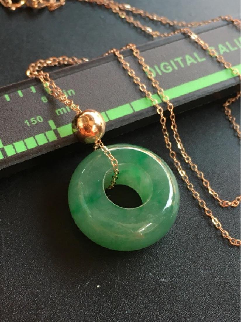 A NATURAL RING-SHAPED JADEITE NECKLACE