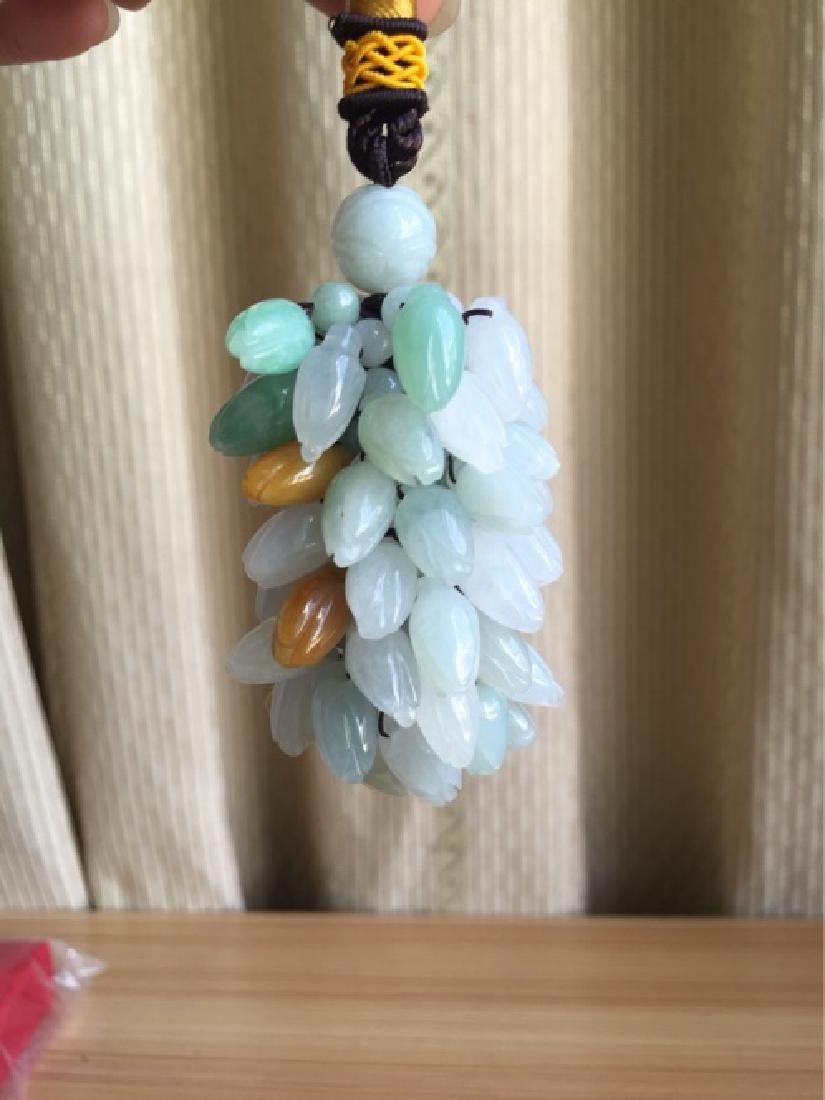 A NATURAL JADEITE BEADS PENDANT