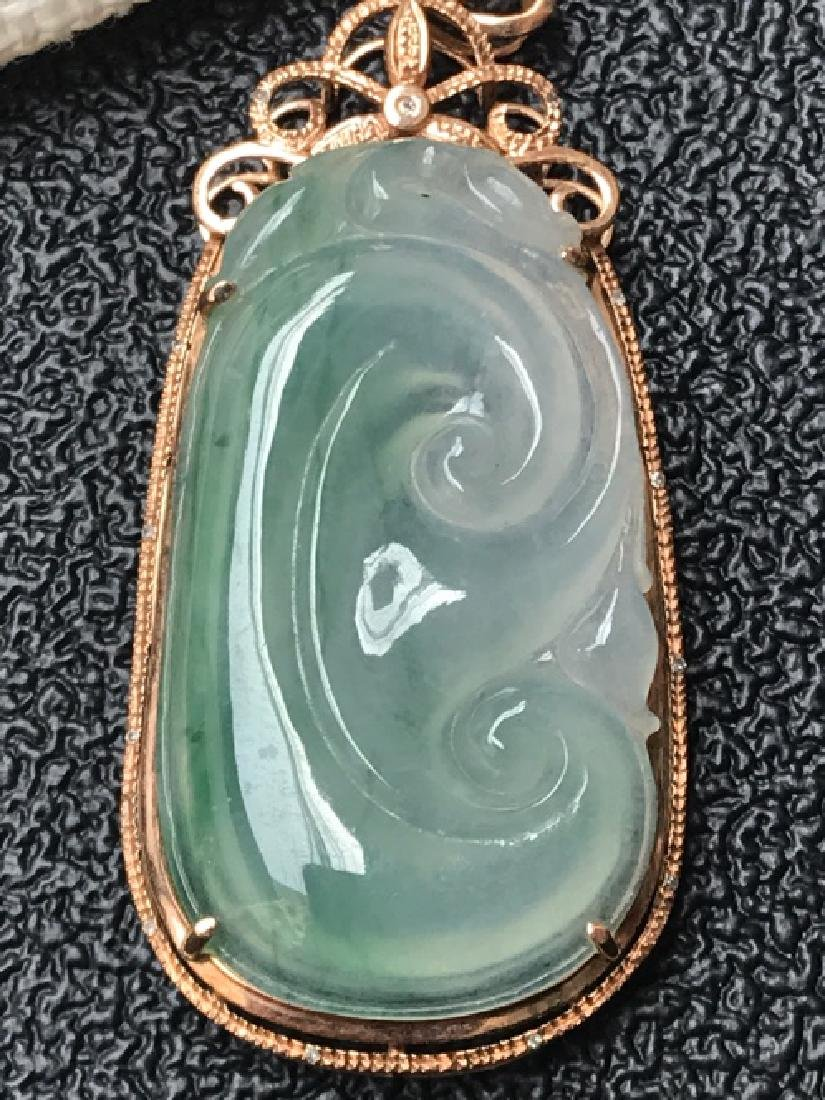 A NATURAL RUYI-SHAPED PIAOHUA JADEITE PENDANT