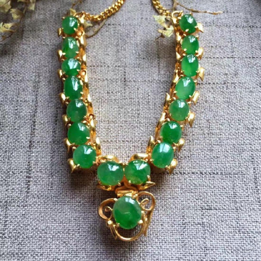 A NATURAL EGG-SHAPED PINGGUOLV JADEITE NECKLACE