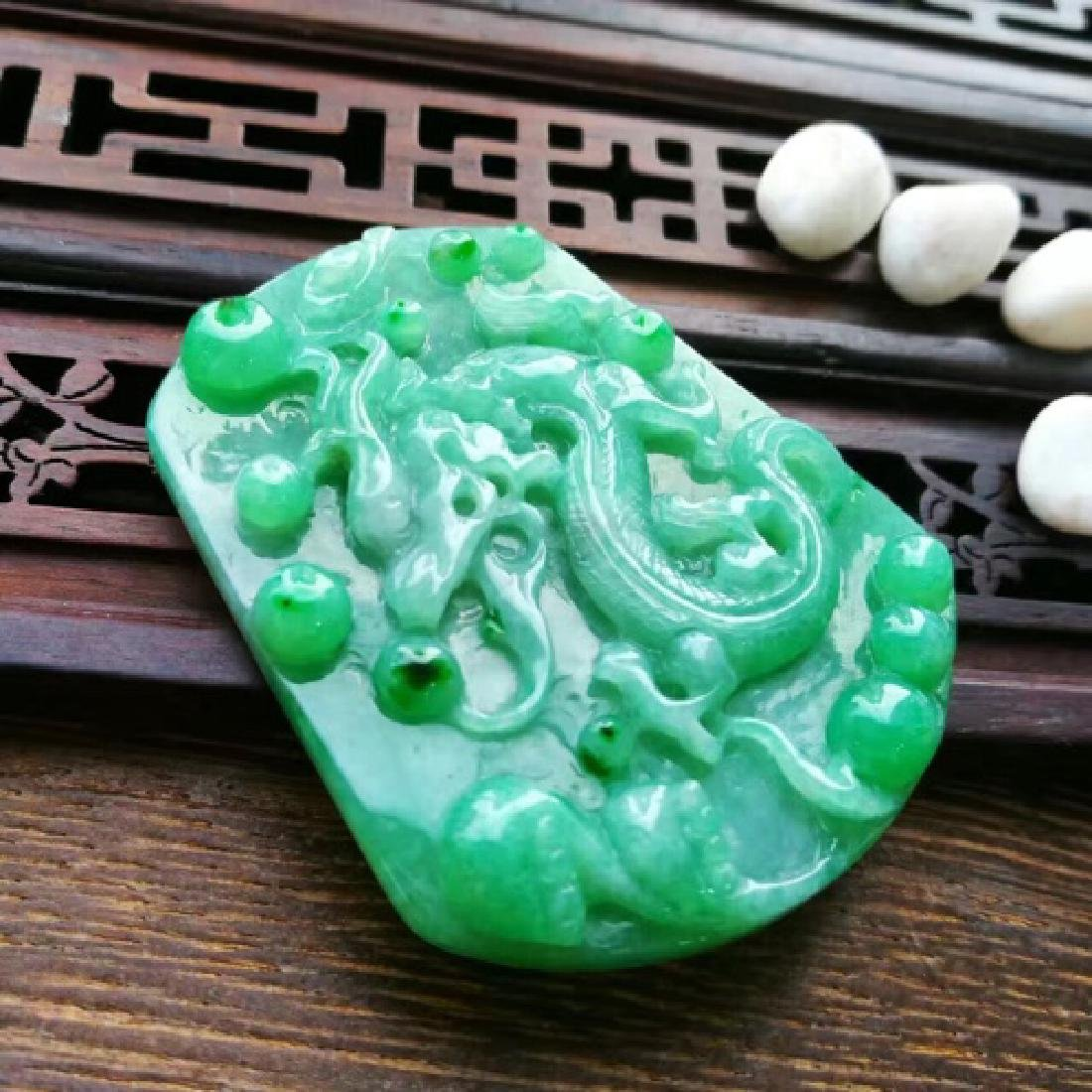 A DRAGON DESIGN NATURAL  ICY JADEITE PENDANT WITH