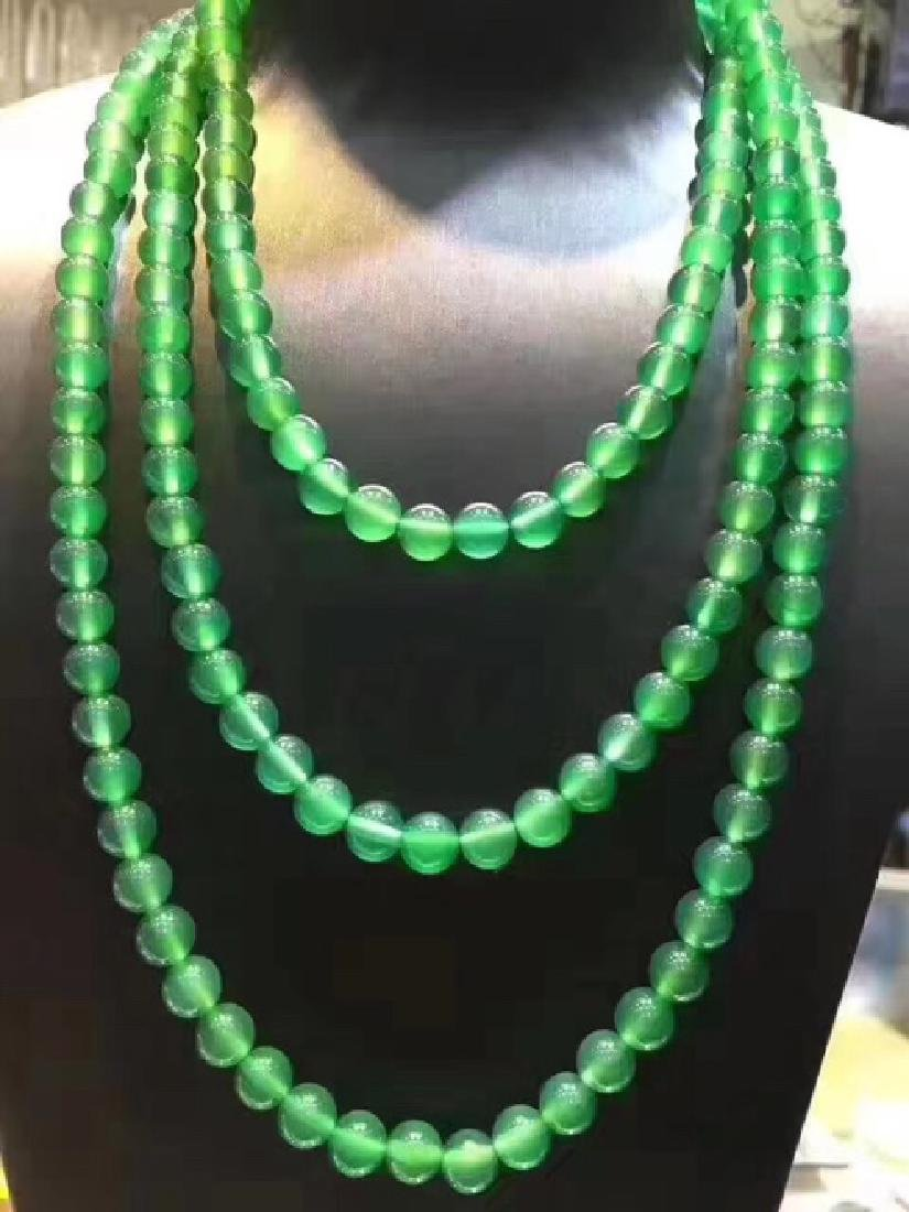 A NATURAL YUSUI BEADS NECKLACE