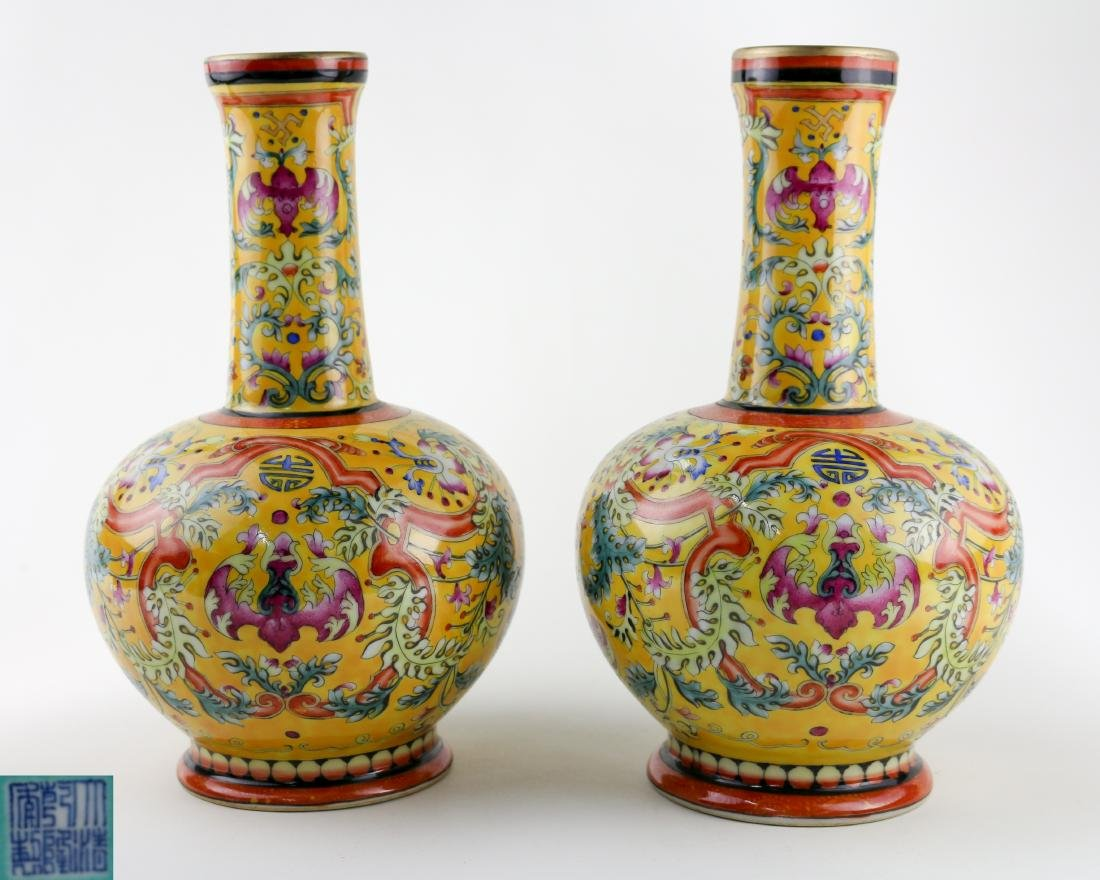 PAIR OF YELLOW GLAZE VASES WITH QIANLONG MARK