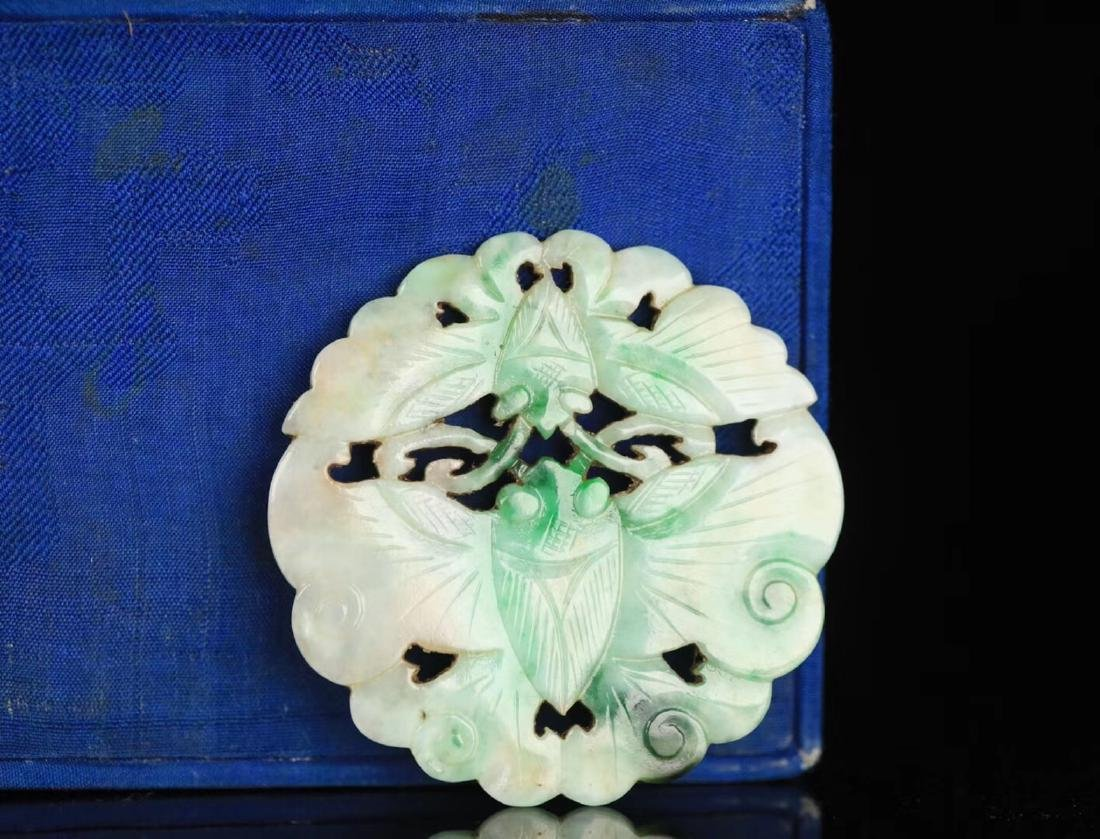 A JADEITE CARVED CIRCLE BUTTERFLY SHAPED PENDANT