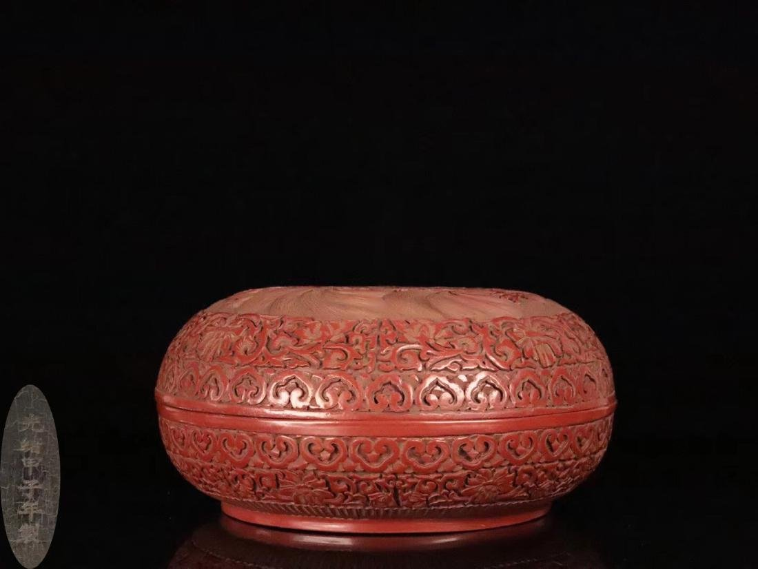 A RED LACQUE CARVED DRAGON PATTERN PEN BOX