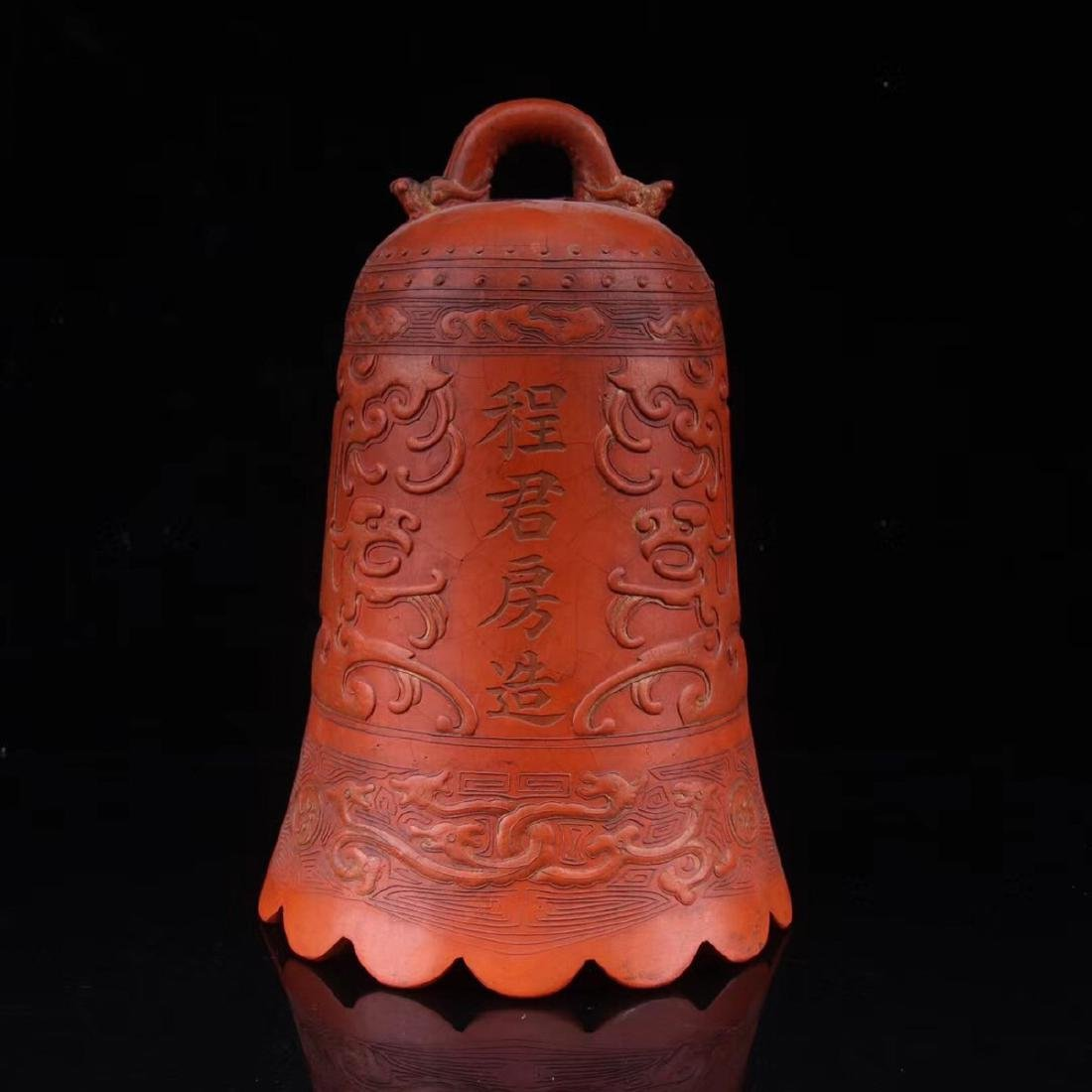A ZHUSHA CARVED BELL SHAPED DECORATION