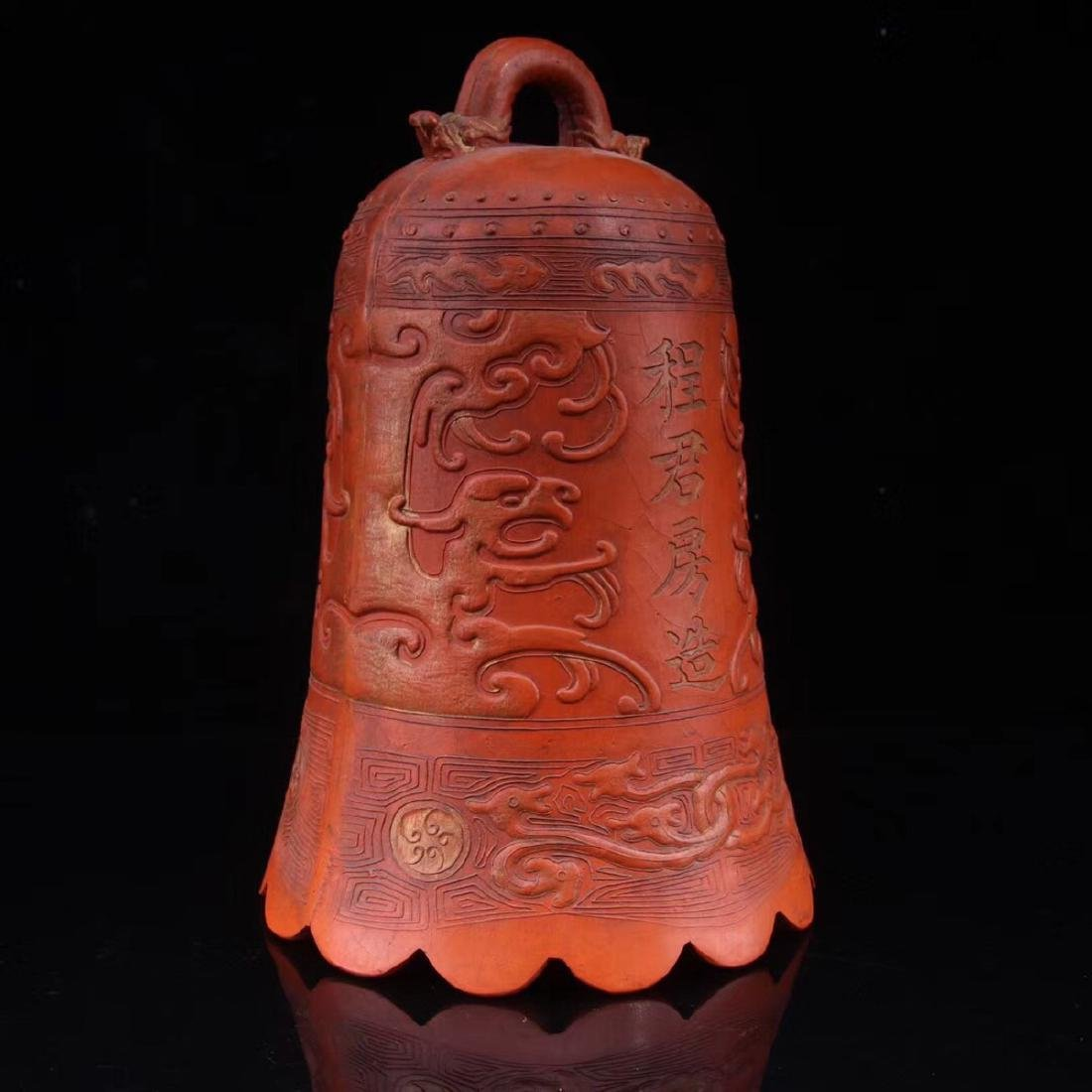 A ZHUSHA CARVED BELL SHAPED DECORATION - 2