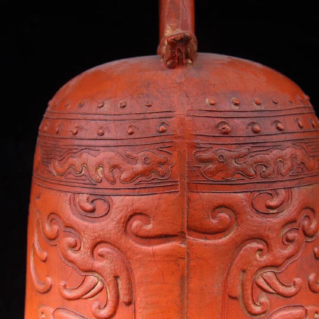 A ZHUSHA CARVED BELL SHAPED DECORATION - 7