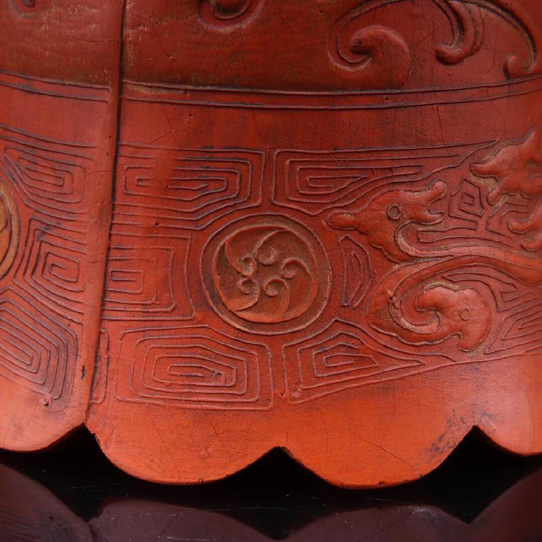 A ZHUSHA CARVED BELL SHAPED DECORATION - 9