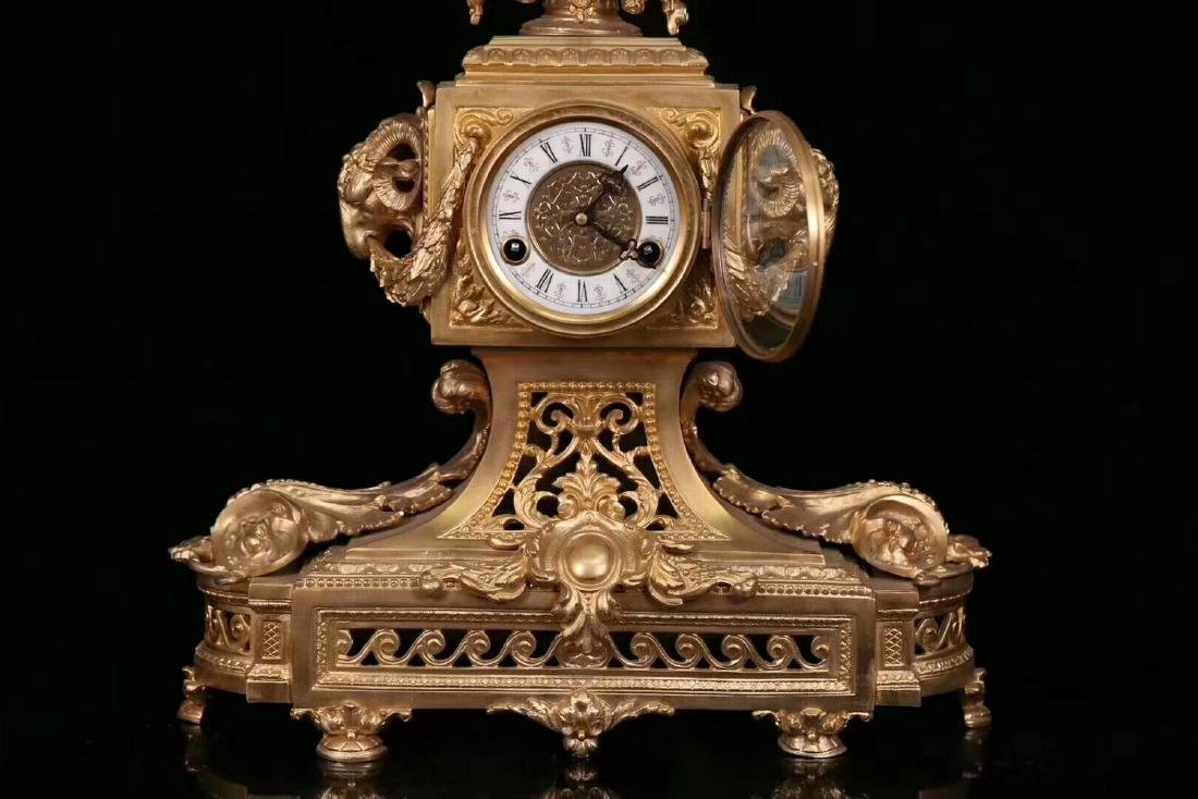 A GILT COPPER CLOCK WITH TWO CANDLESTICK - 5