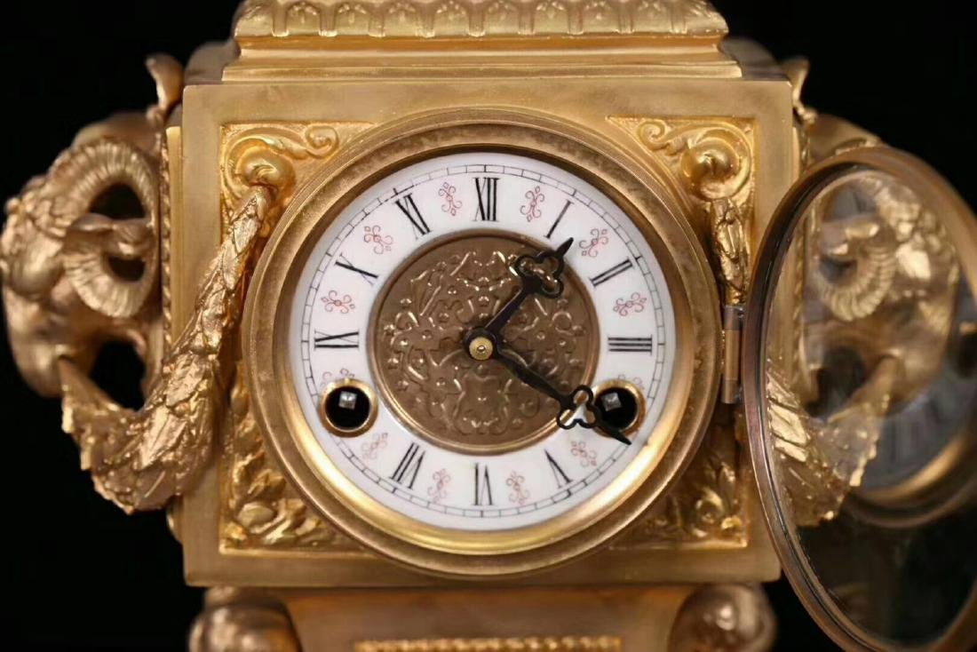 A GILT COPPER CLOCK WITH TWO CANDLESTICK - 6