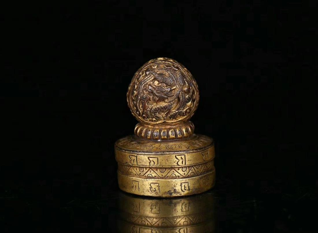 AN OLD GILT COPPER DRAGON SHAPED SEAL