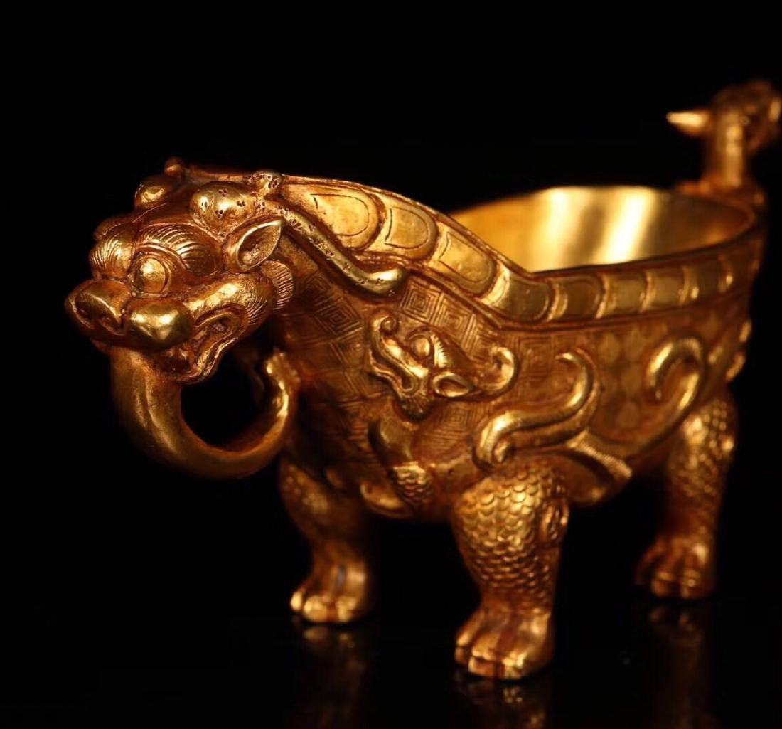 A COPPER GILT BEAST CUP - 2