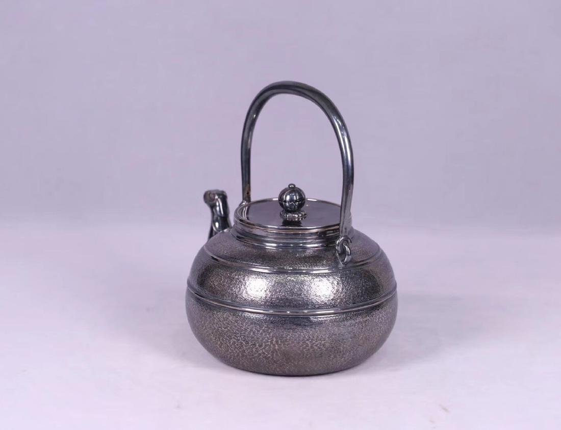 AN OLD SILVER POT - 2