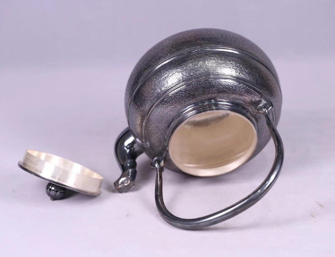 AN OLD SILVER POT - 4