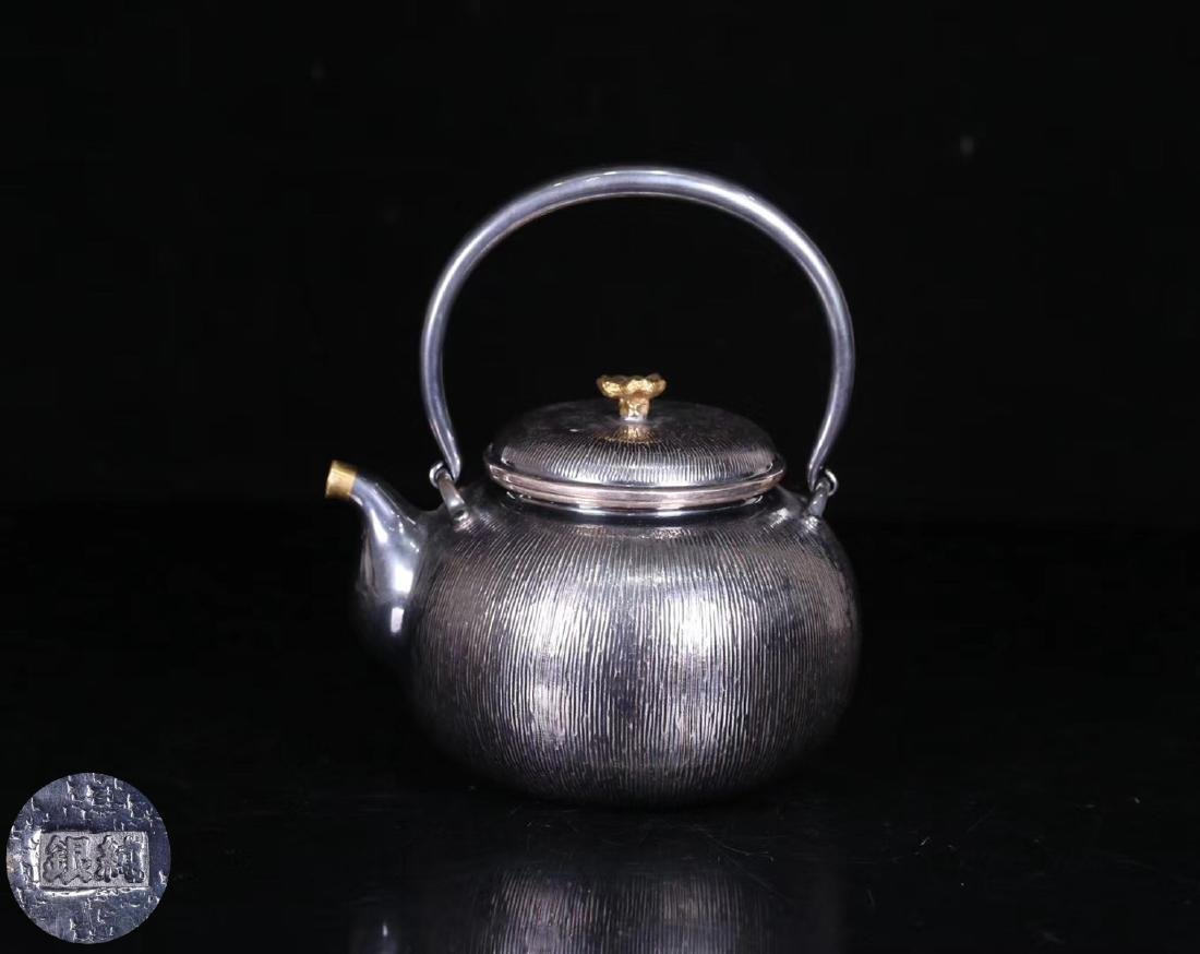 AN OLD SILVER POT