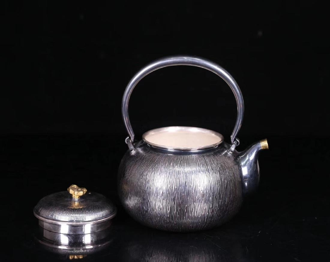 AN OLD SILVER POT - 3