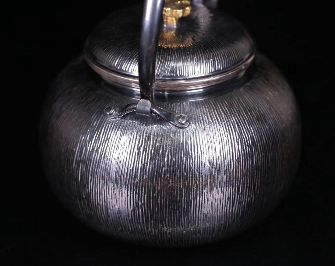 AN OLD SILVER POT - 9