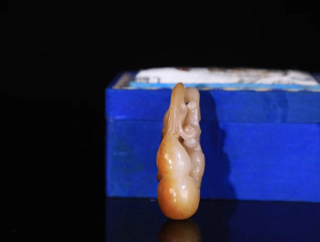 A HETIAN JADE CARVED CHILD PENDANT - 3