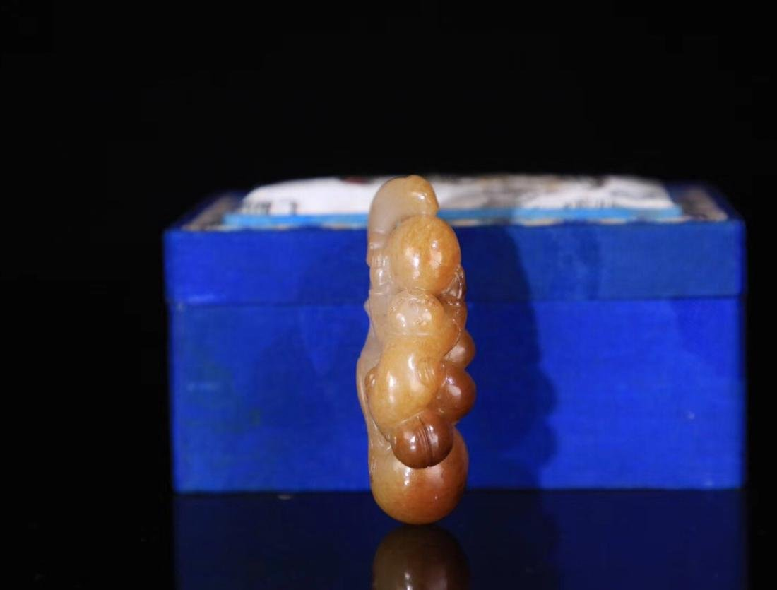 A HETIAN JADE CARVED CHILD PENDANT - 4