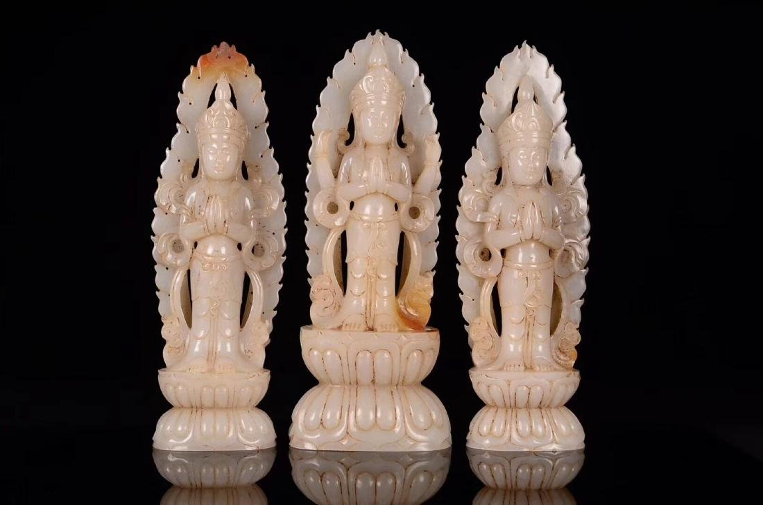 THREE HETIAN JADE CARVED GUANYIN STATUES