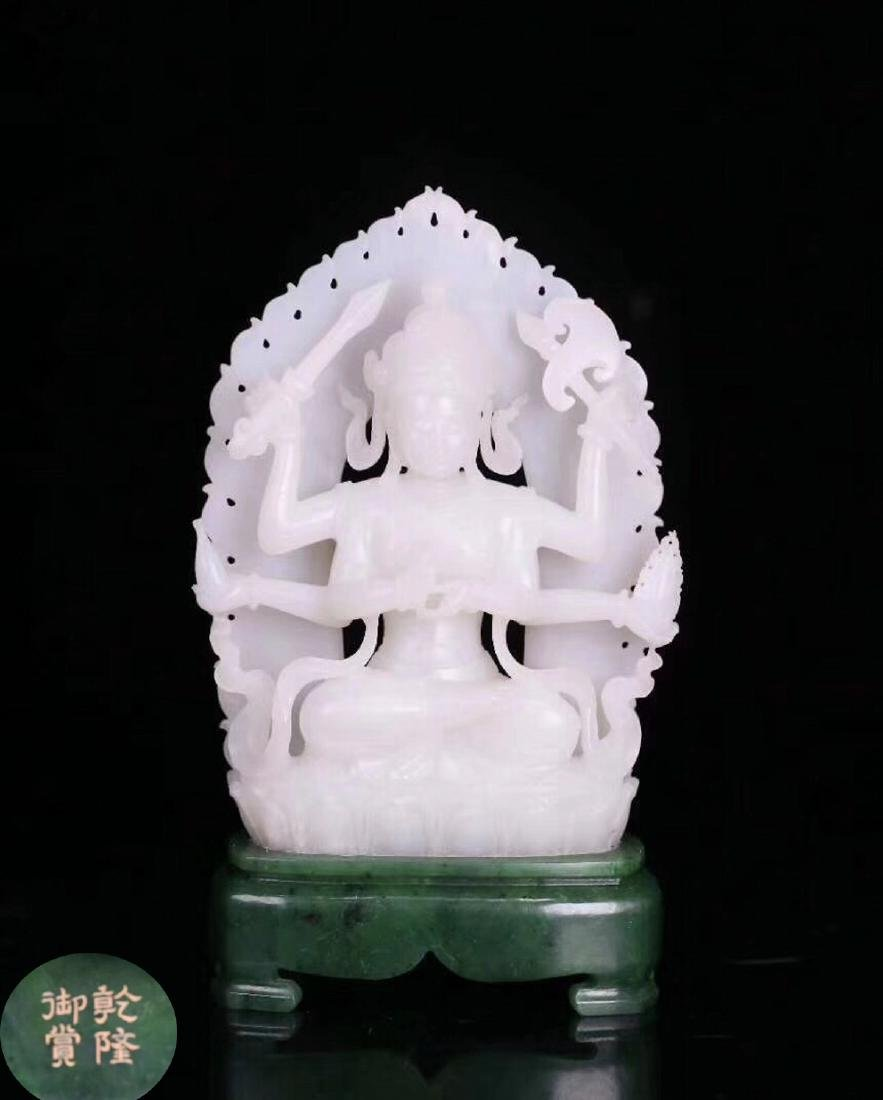 A HETIAN JADE CARVED BUDDHA FIGURE