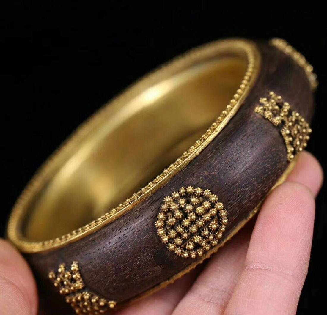 A CHENXING SLIVER GILT SHOUWEN BANGLE - 7