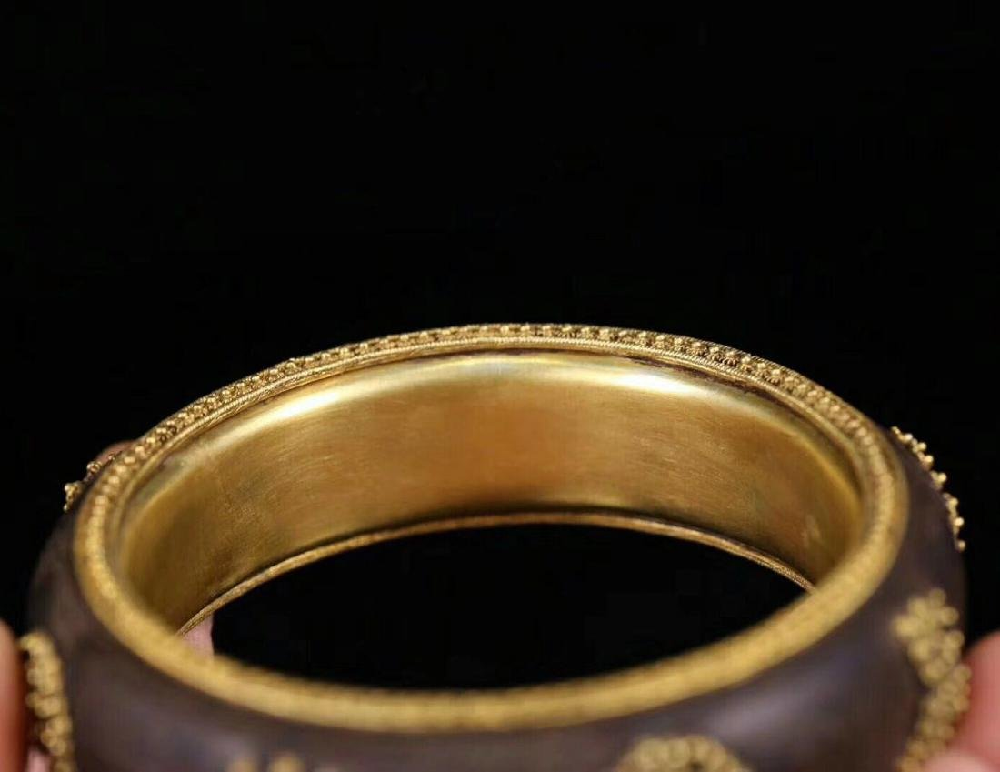 A CHENXING SLIVER GILT SHOUWEN BANGLE - 8
