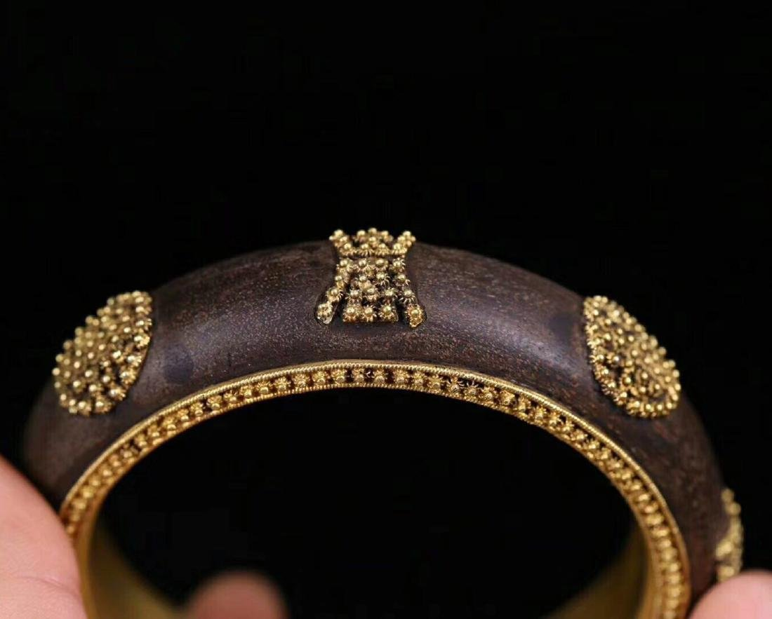 A CHENXING SLIVER GILT SHOUWEN BANGLE - 9