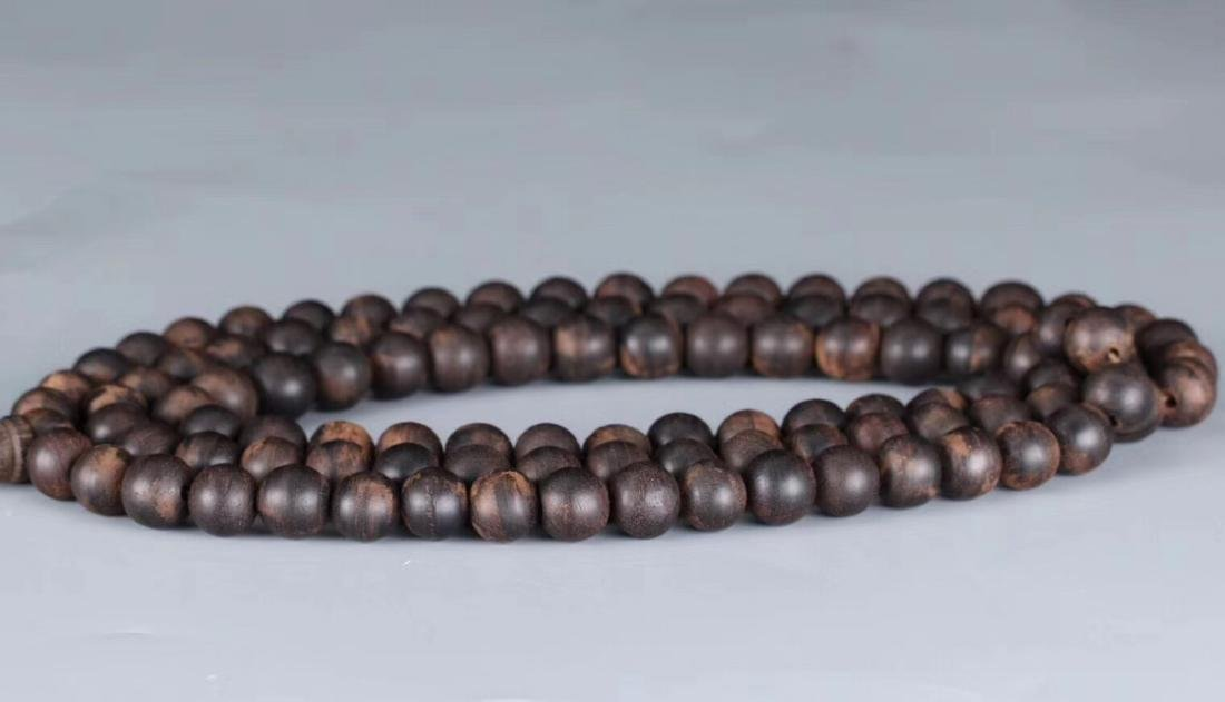 A CHENXIANG WOOD BEADS STRING PENDANT - 2